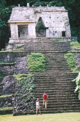 Tourists on Mayan temple steps